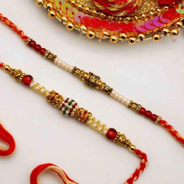 Pearly rakhi set with Gulabjamun and Rasgulla