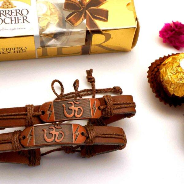 Set of 2 OM bracelet Rakhis with a 3pcs. Ferreo Rocher Combo