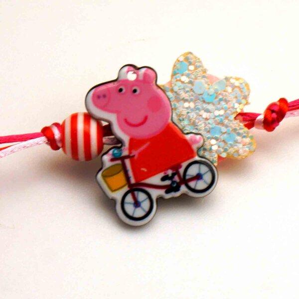 Send Playful cycling Peppa Pig Rakhi to USA