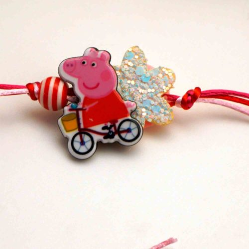 Send Playful cycling Peppa Pig Rakhi to canada