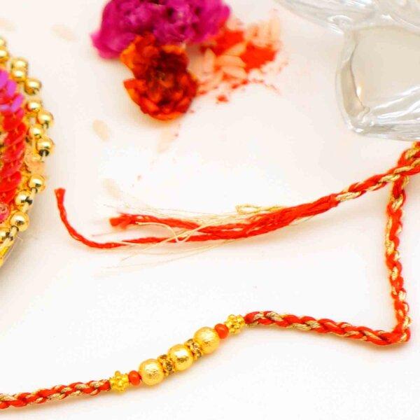 The Golden Bead Rakhi