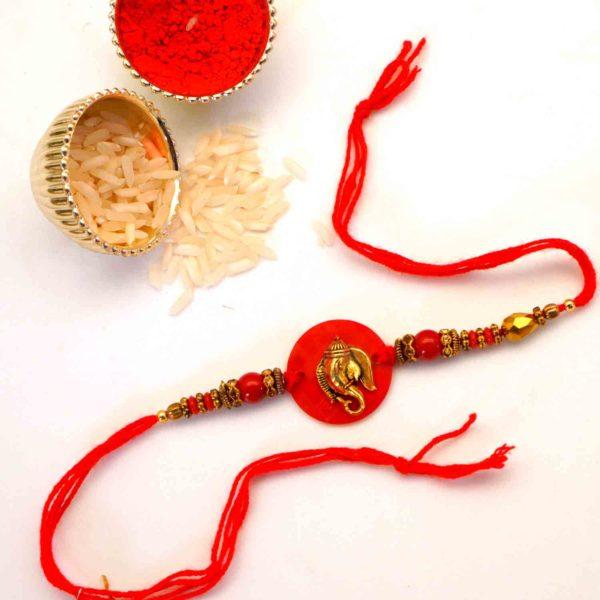 Send red dial ganesh rakhi to Texas