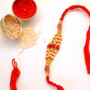 White and Red Beaded Rakhi