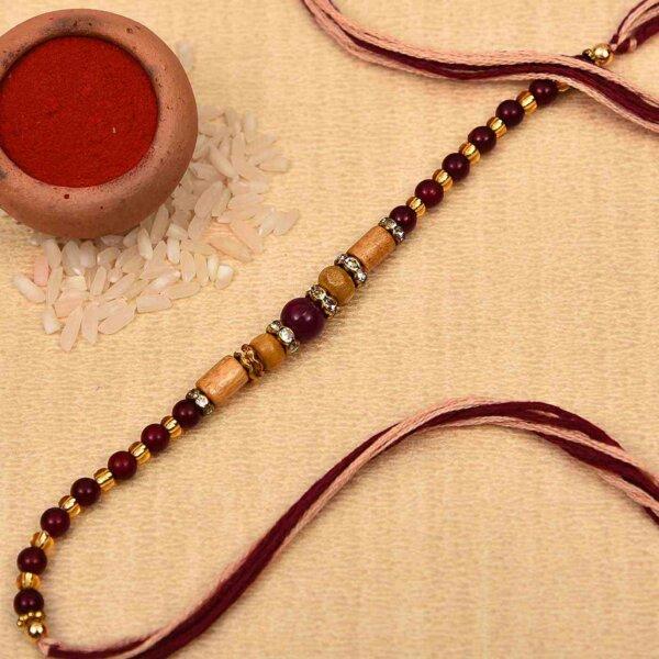 Elegant golden and brown beads rakhi