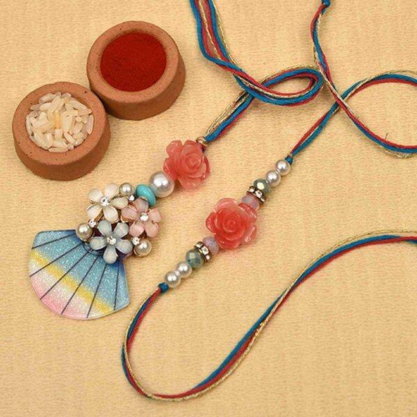 Modern blue-red rose & pearl rakhi