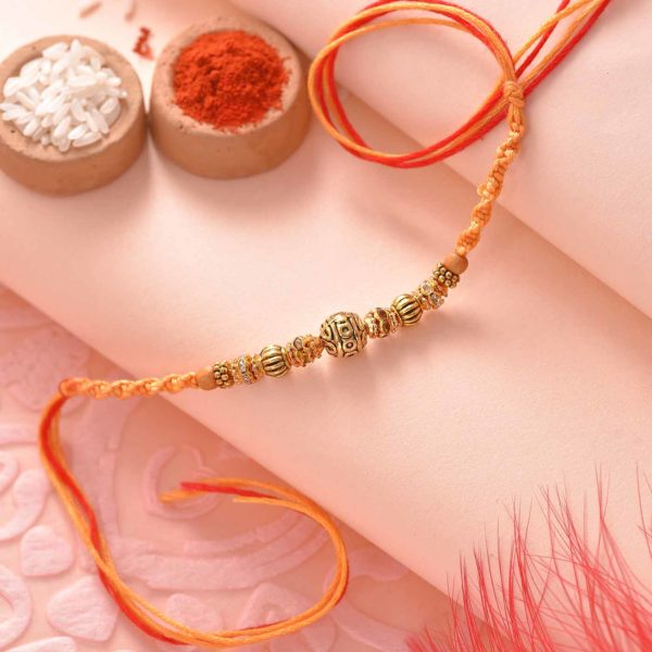 Antique Golden beads and stones Rakhi