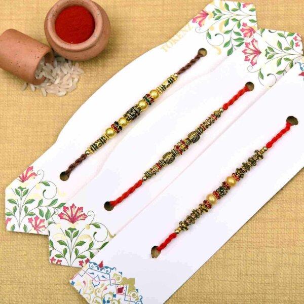 Set of 3 metallic finish beads & pearl rakhi