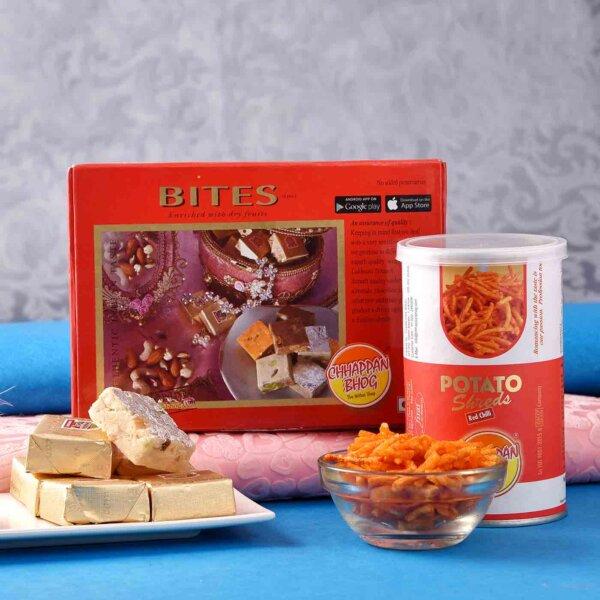 Mewa Bites and Potato Shreds with Antique Tortoise and Lion Face Rakhi Set.