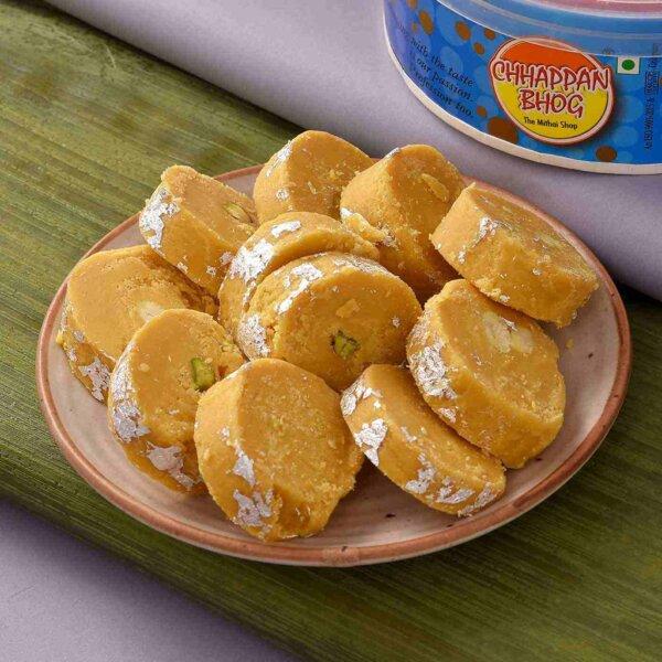 Batisa Slice with Coriander Flavoured Roasted Cashewnuts and Elegant Om Ganesha Rakhi Set.