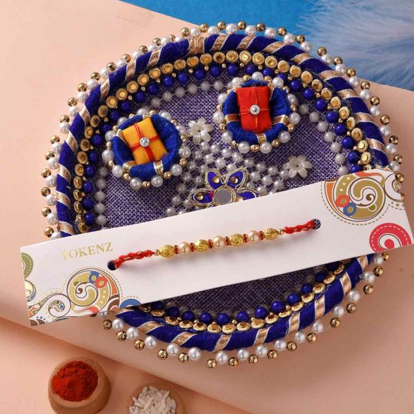 Elegant Pearl-Golden Bead Rakhi with Navy Blue Thali