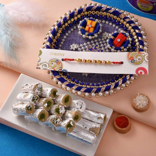 Peacemaker Golden-Pearl rakhi with Pista Roll and 6 inch thali.