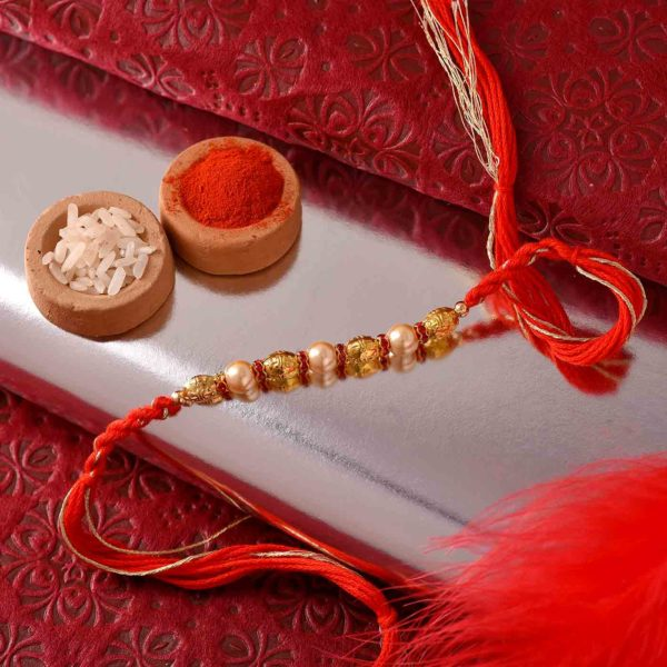 Golden Pearl Rakhi With Dual-Toned Thread