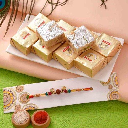 Mewa Bites With rudraksh and Ghungroo Beads Rakhi.