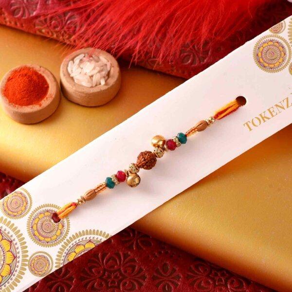 Beautiful Rudraksh and Ghunghroo rakhi with Mewa Bites and Thali