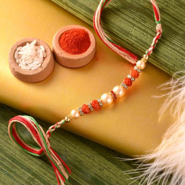 Mewa Bite with Exquisite Pearl and Beads Rakhi