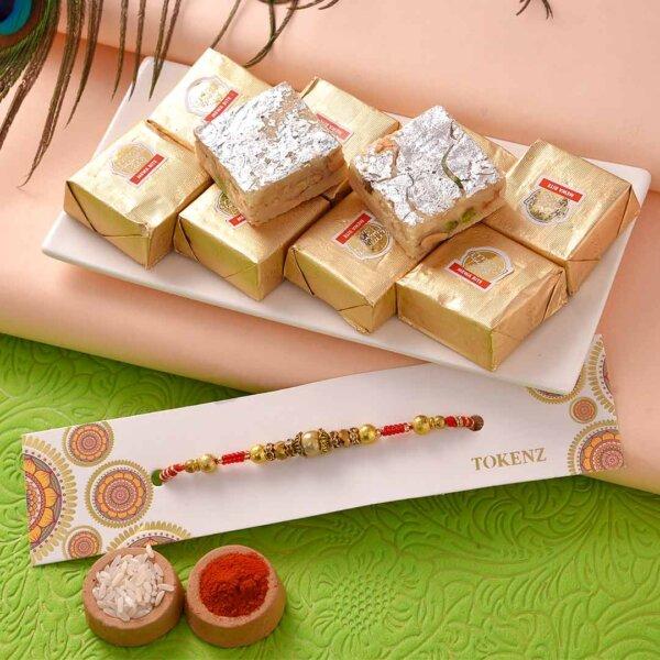 Mewa Bite with Lovely Golden Beads Rakhi