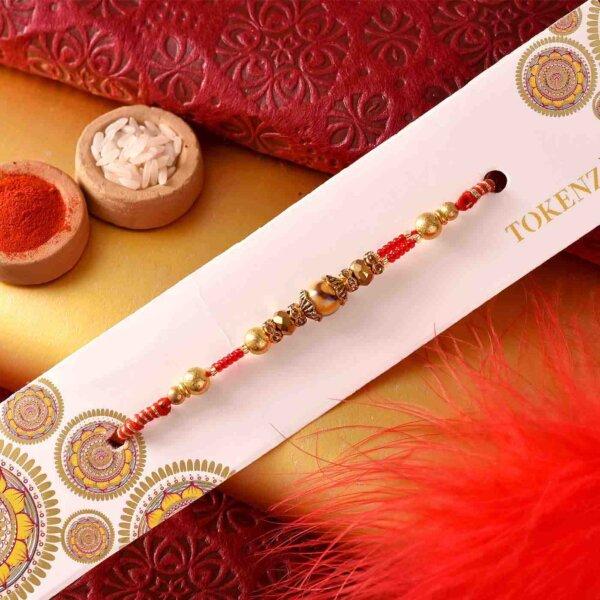Stunning Pearl-crystal rakhi with Mewa bites and Thali.