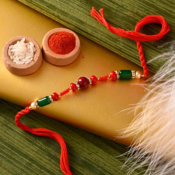 Unique Red-Green Rakhi with Kesar peda and thali.