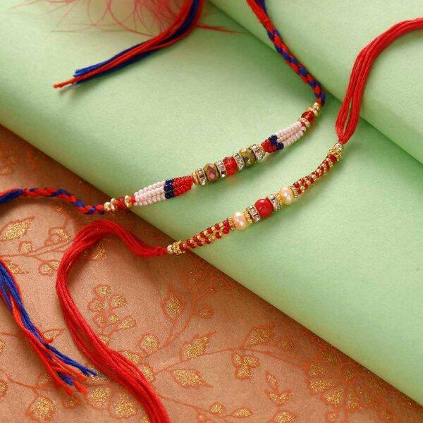 Set of 2  Red White and Golden Beads Rakhiand 200 gms Kaju Katli