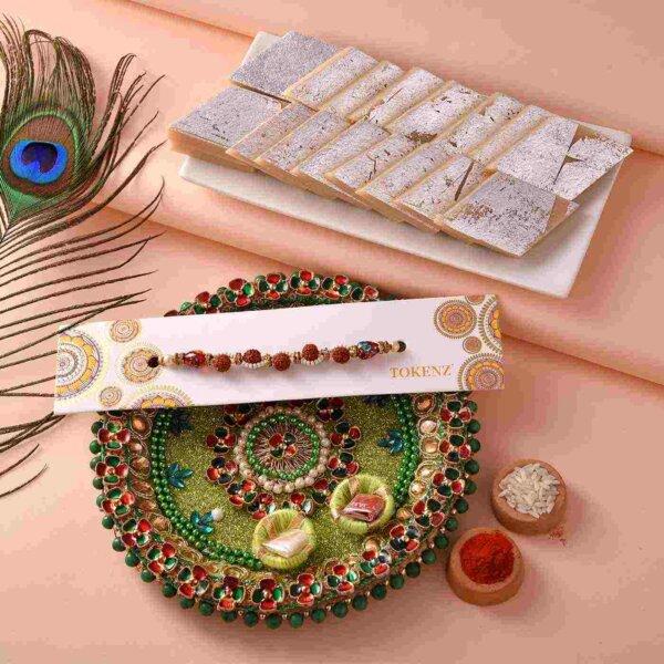 Elegant white beads and Rudraksh Rakhi with Kaju Barfi & 5inch Thali