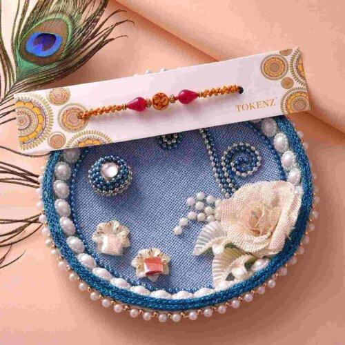 Ethnic Om Rakhi and Floral 6inch Blue Thali Set