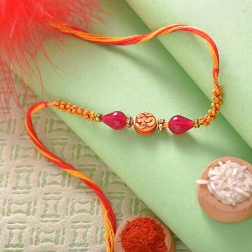 Beautiful Om and Wooden Beads Rakhi Thread with Mouthwatering Kaju Katli.