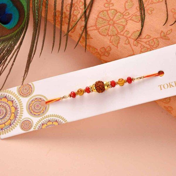 Red -orange beads with rudraksh rakhi , Besan ladoo and Thali