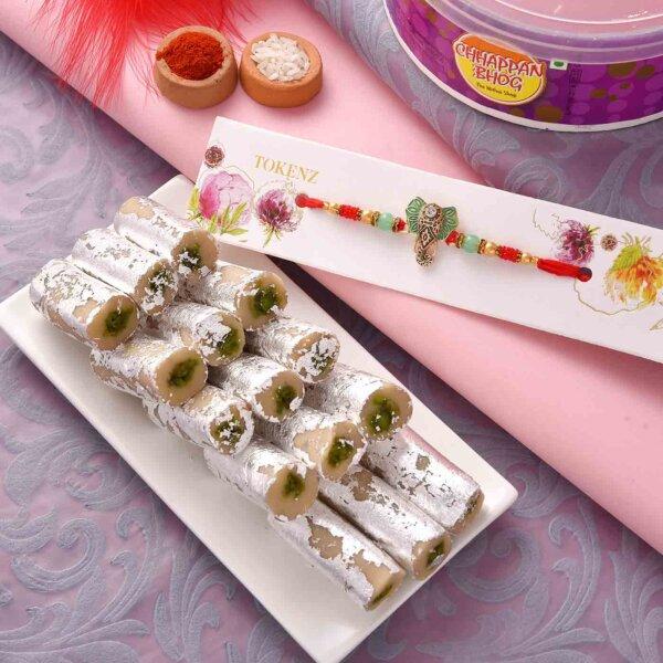 Pista Roll with Designer Ganesha Face and Beads Rakhi