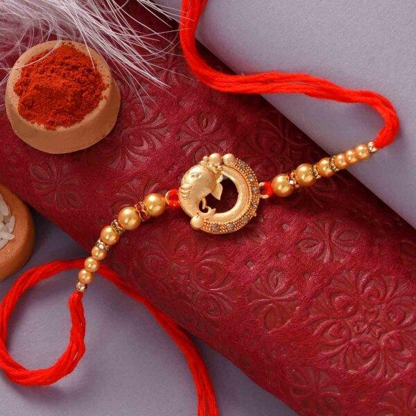 Ganesha Pearl Rakhi with Red Thali