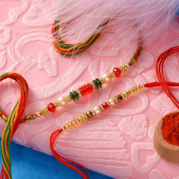 Red crystal Set of 2 rakhi wih mewa bites and Flower patterned thali
