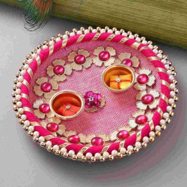 Rudraksh with colorful beaded rakhi, Batisa slice & Pink thali.