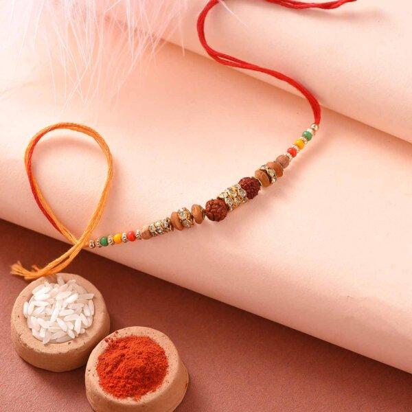 Batisa Slice with rudraksh and Colorful Beads Rakhi