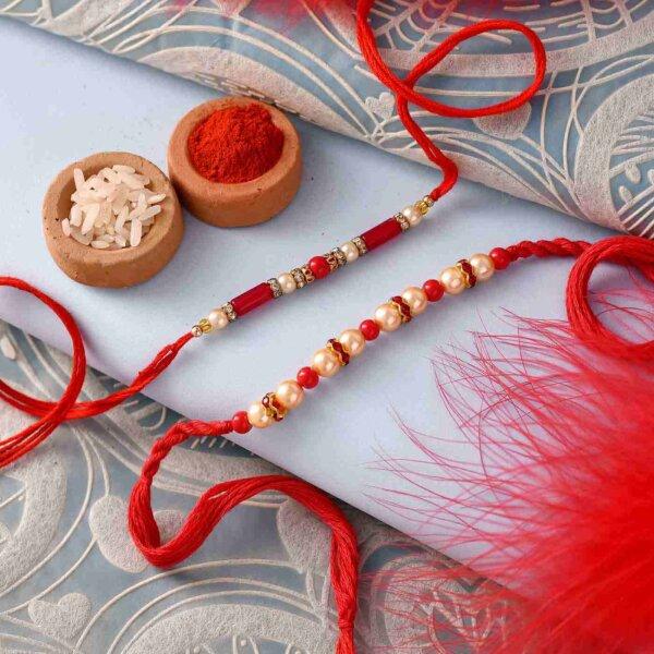 Pretty Set of two rakhi with kaju barfi & cream golden thali