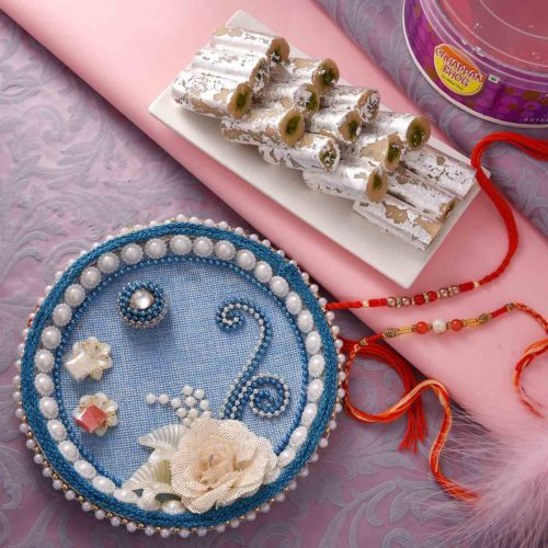 Set of two rakhi with red and orange round beads ,Pista roll and Thali