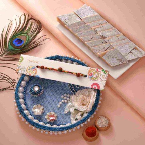 Simple rudraksh on twisted thread with Kaju Barfi & Blue floral thali