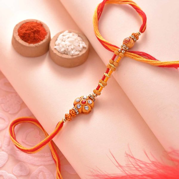 Kesar Peda Paired with Flower and Beads Rakhi