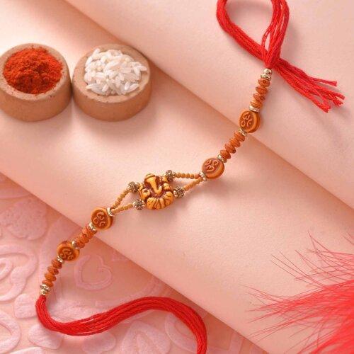 Kaju Barfi Paired with Om Ganesha Beads Rakhi