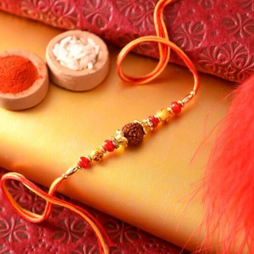 Traditional rudraksh with yellow and red pearl Rakhi