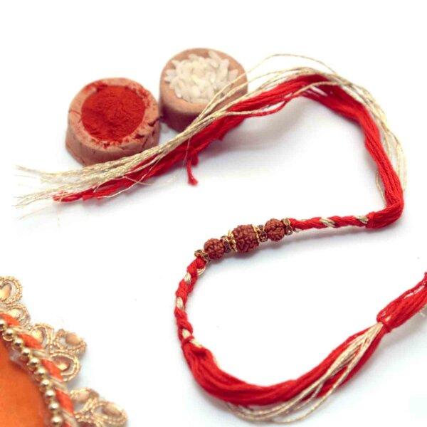 Auspicious Rudraksha with Golden String Rakhi