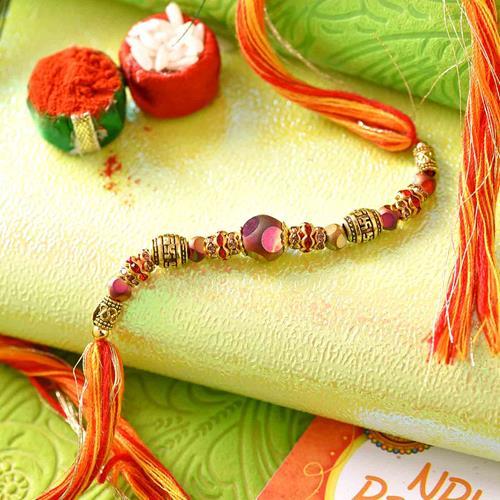 Orange bead Rakhi