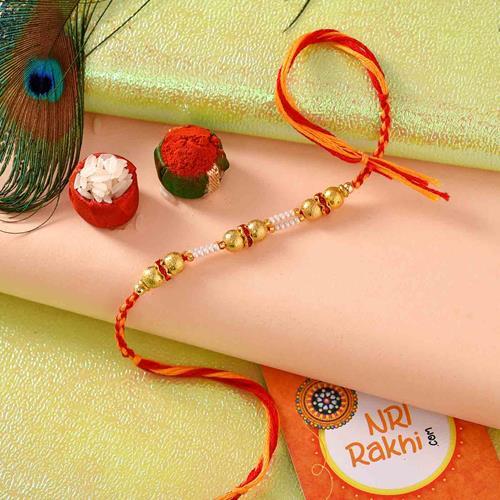 Gold bead rakhi