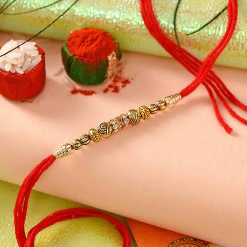 The Golden thread with Rakhi card