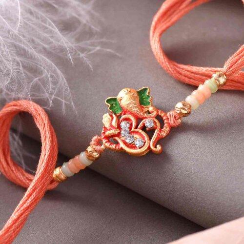 Sacred Ganesha Rakhi With 3D OM Design