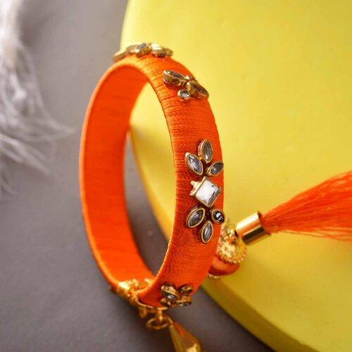 Orange Lumba Rakhi With Danglers & Sequins