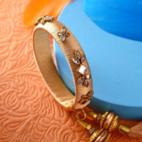 Golden Lumba Rakhi With Sparkling Stones