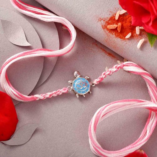 Silver OM Rakhi With Pink Thread