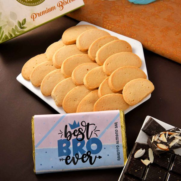 Traditional Red Thread Rakhi With Handmade Roasted Almond Chocolate Bar (100 gm) &Cheese Biscotii (300gm )