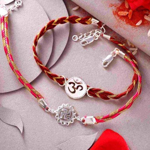Set Of 2 Silver Swastik & White OM Rakhi