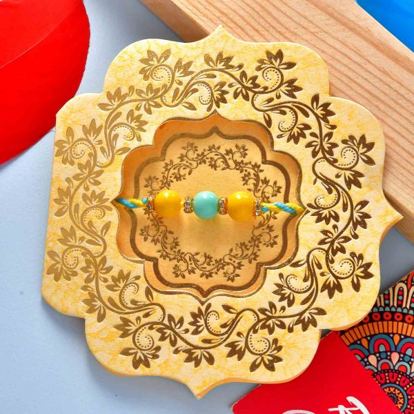 Set Of 2 Blue & Yellow Beads Rakhis With Chocolate Dipped Blueberry Dates (100 Gms)