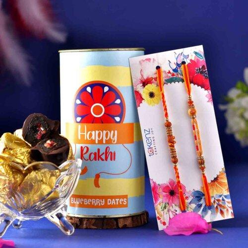 Set Of 2 Elegant Rakhis With Chocolate Dipped Blueberry Dates (200 Gms)
